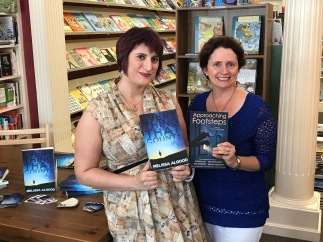Patricia Flaherty Pagan with 'Approaching Footsteps' which includes my piece 'Thomas' and myself with my debut ya novel 'Everything That Counts'.